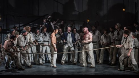 BILLY BUDD by Britten; Opera North; Gand Theatre; Leeds, UK; 15 October 2016; RODERICK WILLIAMS as Billy Budd; EDDIE WADE as Donald (centre); DANIEL NORMAN as Red Whiskers; GARRY WALKER - Conductor; ORPHA PHELAN - Director; LESLIE TRAVERS - Set & Costume Designer; THOMAS C. HASE - Lighting designer; LYNNE HOCKNEY - Movement director; WILL TRISTRAM - Fight director; Credit: © CLIVE BARDA/ ArenaPAL;