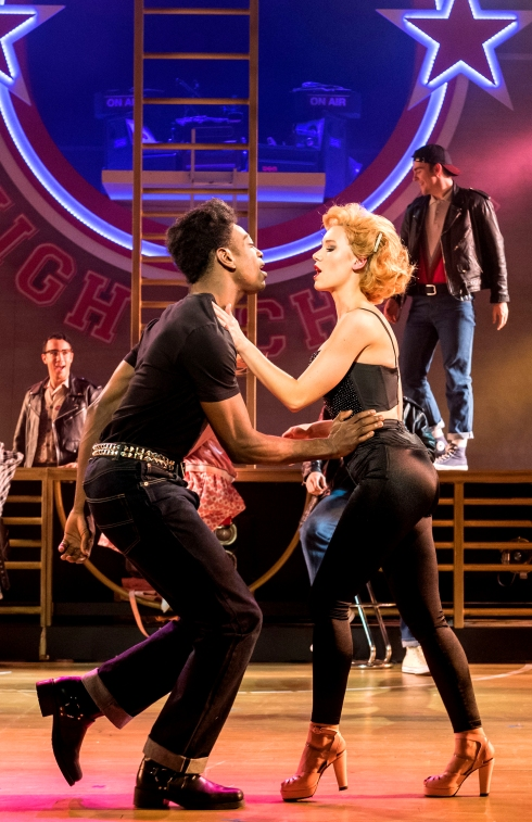 dex-lee-as-danny-zuko-and-jessica-paul-as-sandy-dumbrowski-grease-at-curve-leicester-photo-manuel-harlan